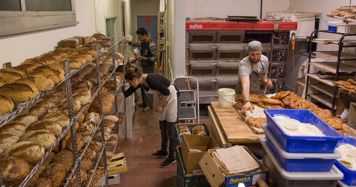 The Shelly Bay Baker team organising the days bread